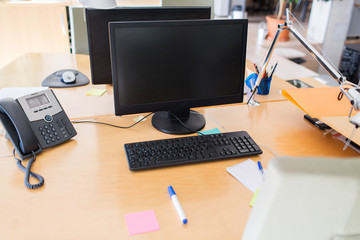 computers with blank black screen on office table