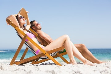 Couple relaxing on deck chair