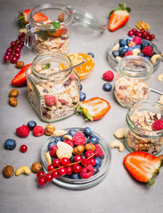 Fresh various berries for Breakfast. Breakfast with muesli in glass jar. Healthy and Clean food concept.