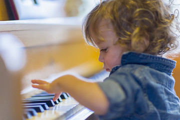 Caucasian baby boy playing piano