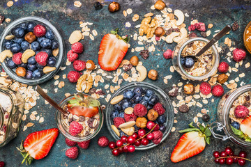 Healthy breakfast ingredients: muesli, various berries , nuts and seed. Healthy breakfast in glass jar. Detox and Clean food concept.