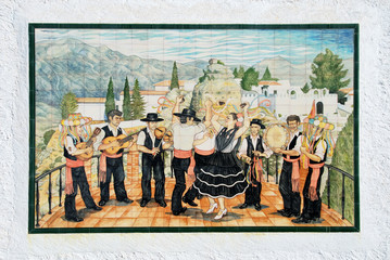 Comares ceramic sign depicting a band of musicians and flamenco dancers, Comares.