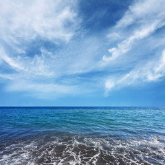 blue sea water and beautiful clouds