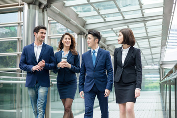 Group of business people walking on bridge in Hong Kong