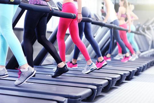 Group of women jogging on treadmill