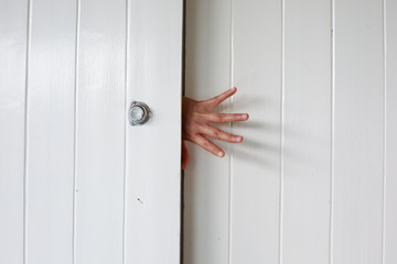 hand on wooden door