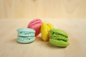 Spoed Foto op Canvas Macarons Colorful of macarons on background of brown wood.