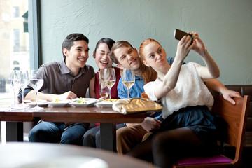 Friends taking selfie in the restaurant