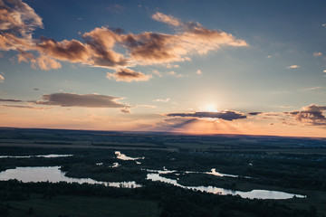 Sunset aerial view of a valley with lakes