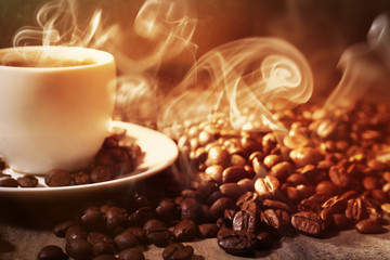 Cup of coffee and grains, closeup