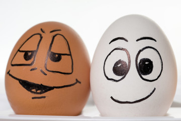 funny easter eggs / Two funny easter eggs in front of a bright background