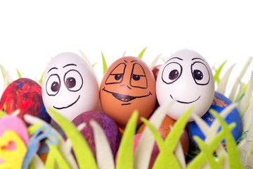 funny easter eggs / Three funny easter eggs in a easter basket