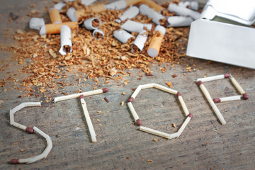 Stop smoking background with broken cigarettes and tobacco