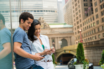 Couple reading text message on mobile phone