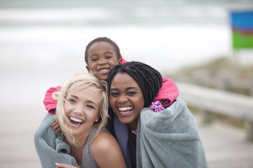 Two young women and boy on beach
