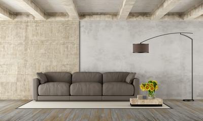 Grunge room with modern sofa