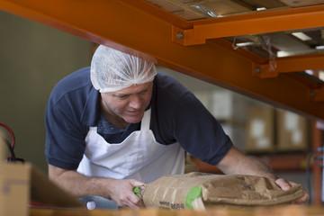 Factory worker handling parcel