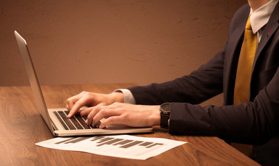 Businessman is suit working on laptop