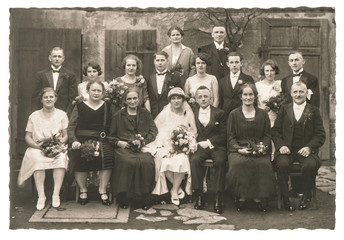 Old family wedding photo. Antique fashion dress