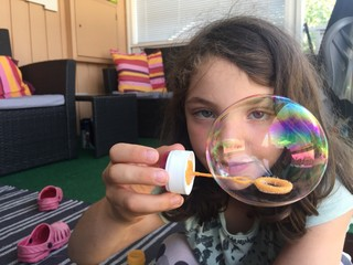 Girl with soap bubble.