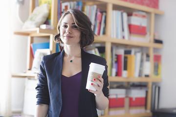Young woman taking coffee break