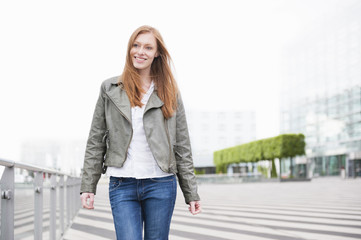 Young woman on strolling city street