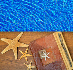 Photo album with starfish on a background of blue water.