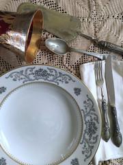 Vintage silverware and porcelain plates