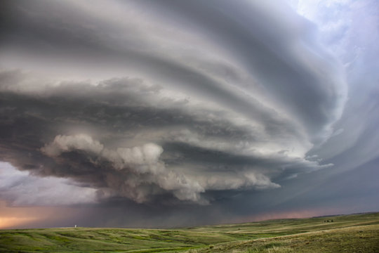 Anticyclonic supercell thunderstorm swirling over plains, Colorado, USA