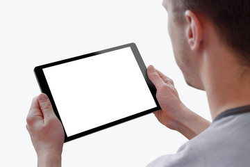 Tablet with isolated screen for mockup in man hands. Isolated white background. Isolated device screen for design, interface promotion.