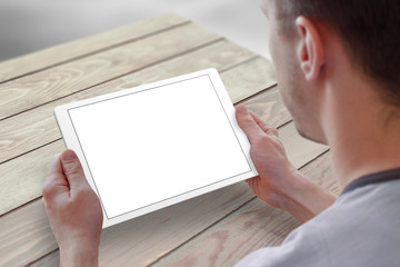 Tablet with isolated screen for mockup in man hands. City life in background. Isolated device screen for design, interface promotion.