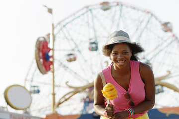 Portrait of young woman with ice cream cone, Coney Island, Brooklyn, New York, USA