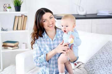 Happy woman with baby boy, closeup