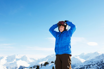 Portrait of boy with hands on head, Les Arcs, Haute-Savoie, France