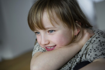 Portrait of girl resting on elbow