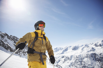 Low angle view of mid adult male skier on mountain, Austria
