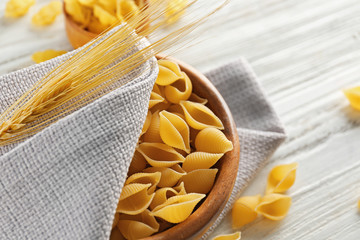 Raw pasta on wooden table closeup