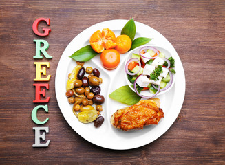 Traditional Greek lunch on wooden background