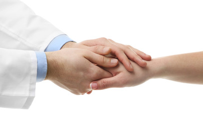 Male doctor holding patient's hand, isolated on white