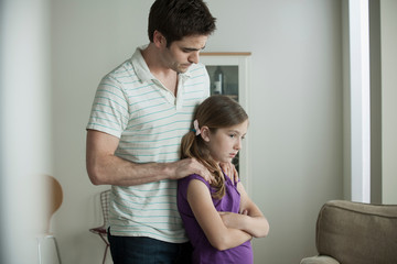 Father reassuring daughter