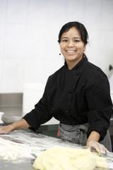 Woman working in restaurant kitchen