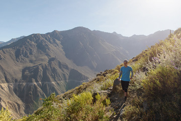 Young woman jogging in Colca Canyon, Cabanaconde, Peru