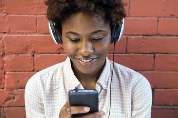 Portrait of young woman wearing headphones