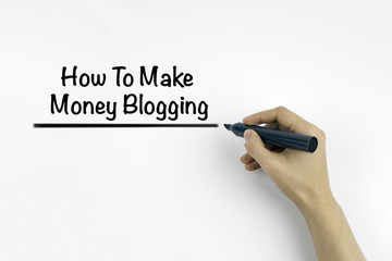 Hand with marker writing: How to make money blogging