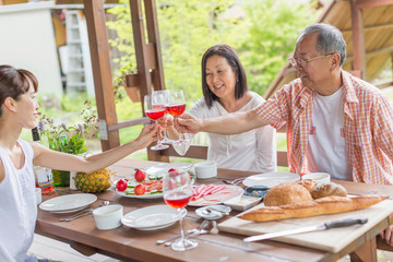 Family toasting at dining table