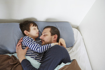 Father and son in bed