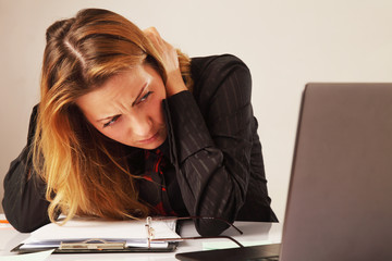 tired and exhausted business woman working  working with laptop