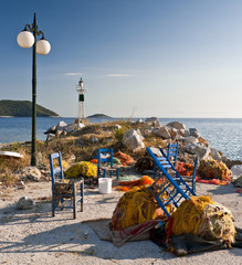 Fishing nets and blue chairs