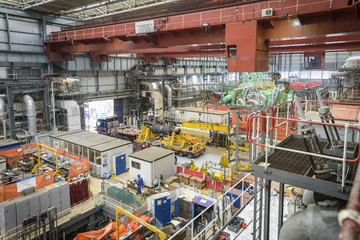 Turbine hall in repair during power station outage, high angle view