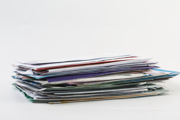 A scattered stack of regular envelopes with delivery stamps and